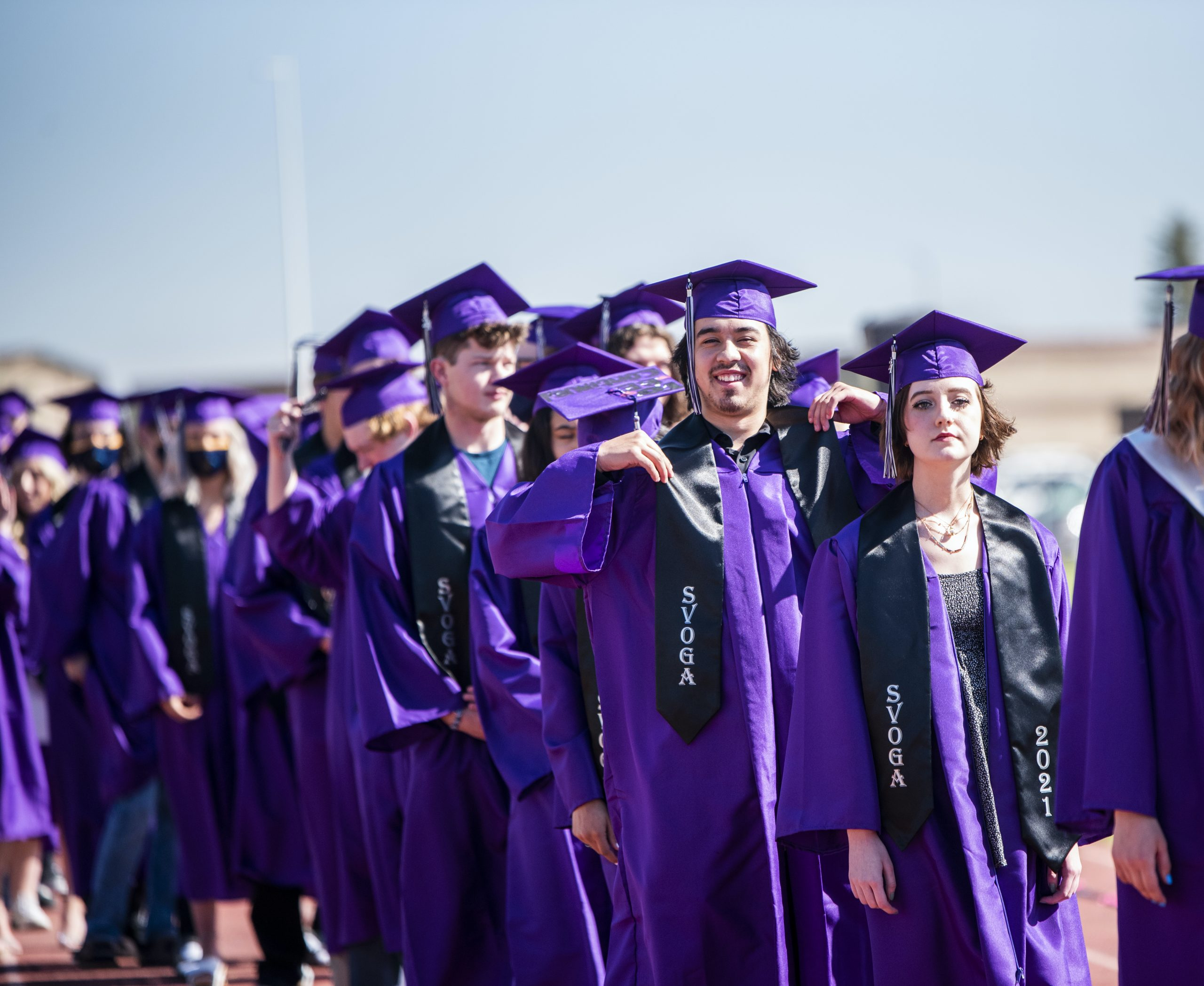 Male graduate with a big smile during graduation line up