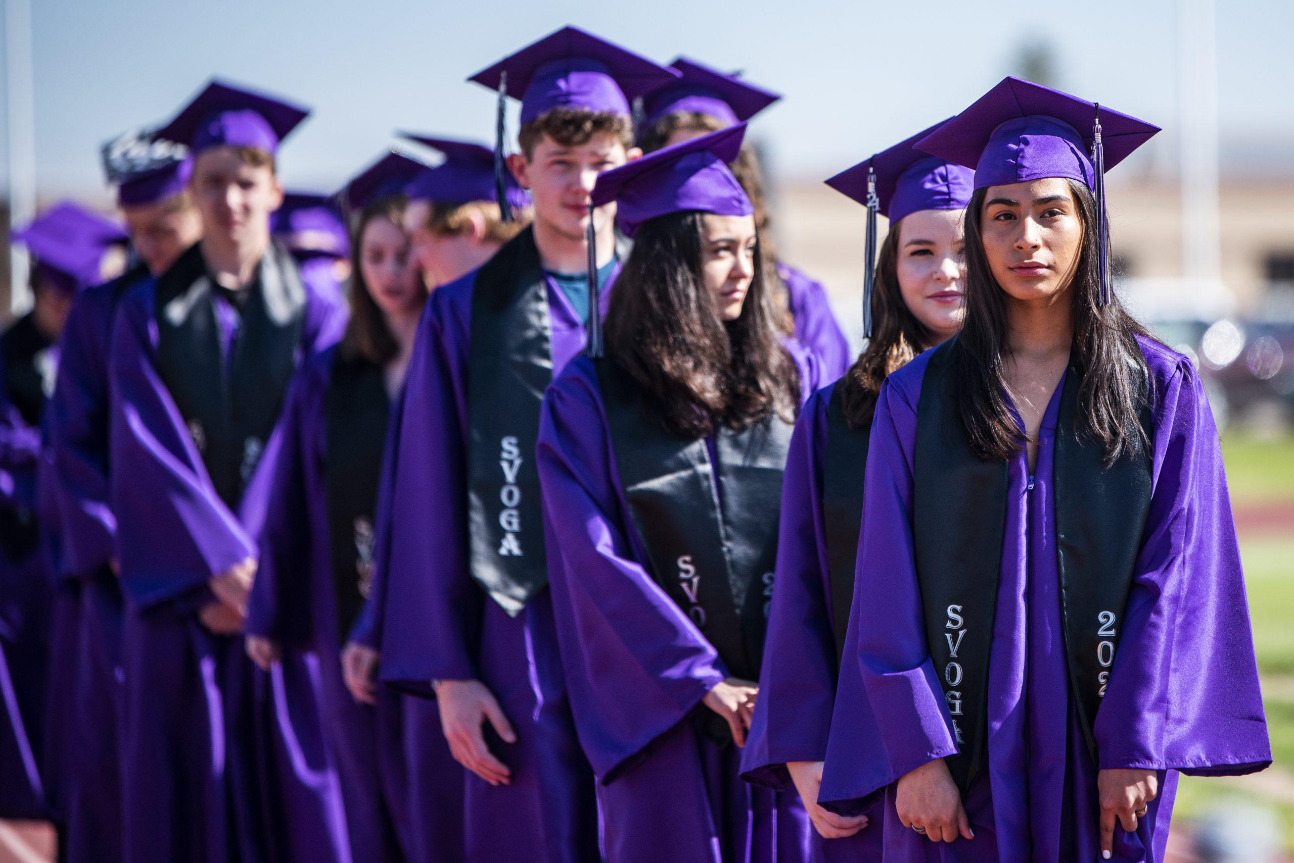 Graduates lined up preparing to receive diplomas